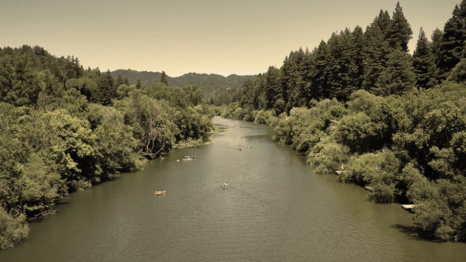 Russian River Valley - river photo banked by green on either side